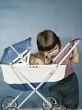 1950s-1960s Little Girl Hugging Cocker Spaniel Puppy Riding in a Baby Carriage Studio Photographic Print