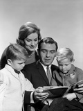 1960s Family Father Mother Sons Reading Book Together Photographic Print