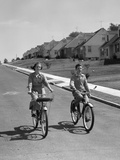 1950s Teen Boy Girl Riding Bikes Suburban Neighborhood Street Photographic Print