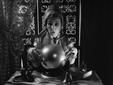 1970s Gypsy Peering into Crystal Ball with Look of Surprise on Face Photographic Print