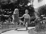 1950s Two Children Holding Hands Smiling Walking Along Sidewalk Photographic Print