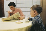 Boy Eating Cookies and Milk as Mom Reads Photographic Print by William Gottlieb