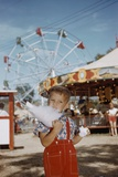 Boy Eating Cotton Candy at Fair Photographic Print by William P. Gottlieb