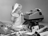 1960s Baby with Adding Machine Telephone Blueprints Paint Samples and Tape Measure Photographic Print