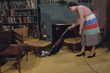 Woman Vacuuming Living Room Photographic Print by William P. Gottlieb