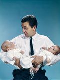 1960s Father Holding Twin Babies Infants Looking Down at One of Them Photographic Print