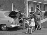 1950s Family Putting Luggage Suitcases into Trunk of Car Photographic Print