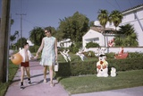 Mother and Son Walking by Christmas Decorations on Yards Photographic Print by William Gottlieb