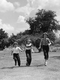 1950s Three Girls Running in Grassy Field Photographic Print