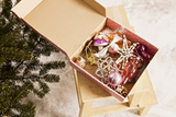 Box with Chistmas Ornaments Next to Christmas Tree, Munich, Bavaria, Germany Photographic Print by Dario Secen