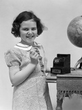 1930s Child Smiling Girl Putting Money Coin into Toy Cash Register Bank Photographic Print