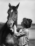 1900s-1910s Young Woman with Upswept Hair Holding Horse by Halter Stampa fotografica