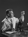 Man Scientist Holding Test Tube Making Notes Photographic Print