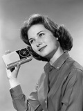 1960s Smiling Teenage Girl Listening to Portable Radio Photographic Print