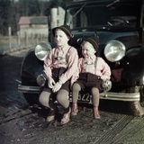 Two Brothers Sit on the Bumper of the Family Mercedes Benz in Germany, Ca. 1949 Photographic Print