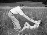 Young Couple Frolicking in Grass Photographic Print by Philip Gendreau