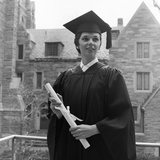 1950s Smiling Female Graduate Holding a Diploma Photographic Print