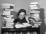 1950s Portrait of Woman Sitting with Stacks of Books Photographic Print