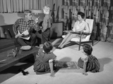 1960s Family of Four in Living Room Boy Is Being Disciplined by Dad Shaking Finger Photographic Print