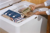 Woman Removing Food from Freezer Photographic Print by William P. Gottlieb