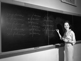 1950s Teacher in Front of Classroom Writing Confidence on Blackboard Photographic Print