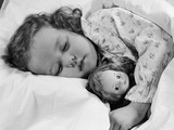 1950s Child Little Girl Sleeping in Bed with Doll Photographic Print