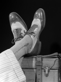 1930s-1940s Crossed Feet of a Man Wearing Wing Tip Spectator Shoes Silk Socks and Striped Trousers Photographic Print