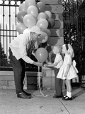 1960s Children Boy Girl Getting a Balloon from Man Photographic Print