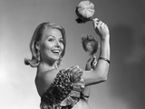 1960s Smiling Blond Woman Shaking Noise Makers in Her Hands Wear Ruffled Halter Top Photographic Print