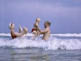 1970s Family Playing in Ocean Surf Photographic Print
