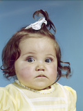 1960s Brunette Baby Girl Ribbon Topknot Yellow Shirt with Chubby Cheeks Round Face Photographic Print