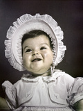 1940s-1950s Baby Brunette Portrait Wearing White Ruffled Dress Big Bonnet Hat Photographic Print