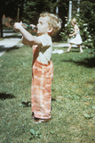 1950s Little Boy Outside Drinking Soda from a 7Up Bottle 1951 Photographic Print by G. Knapp