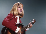 1960s Blond Teenaged Girl Singing and Playing Acoustic Guitar Photographic Print