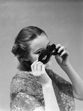 1930s-1940s Woman Putting on Taking Off Black Eye Mask Photographic Print
