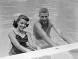 1950s Teen Couple in Swimming Pool Smiling Photographic Print