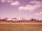 1960s Blurred Motion of Car on Road Photographic Print by Ewing Galloway
