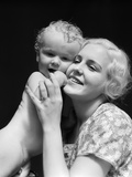 1930s Blonde Woman Mother Smiling Holding Baby to Cheek Photographic Print