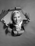 1960s Blond Woman Breaking Through Ripped Paper Smiling Wearing Headband Photographic Print