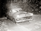 1950s Snow Covered Automobile Driving on Road in Deepening Winter Blizzard Snow Photographic Print
