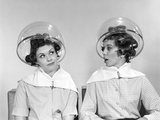 1960s Two Women Sitting under Hairdryers Gossiping Photographic Print