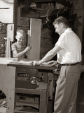 1930s-1940s 1950S Man Father Cutting Wood Board on Table Saw Teaching Boy Son Carpentry Photographie