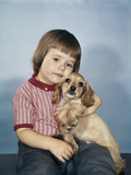 1950s-1960s Winsome Sad Little Girl Sitting Hugging a Cocker Spaniel Puppy Studio Photographic Print