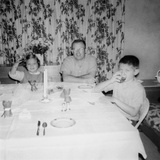 Father with Children at the Dinner Table, Ca. 1962 Photographic Print