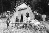 1970s Family of Four Sitting in Front of Tent in Woods, Son Holding Fishing Pole and Big Fish Photographie