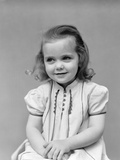 1930s Child Little Girl Posing Sitting with Hands Together Photographic Print