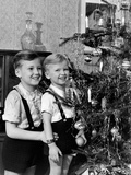 Two Brothers Look at a Christmas Tree in their Living Room in Germany, Ca. 1949 Photographie