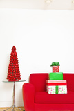 Stack of Christmas Gifts on Sofa Photographic Print