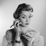 1950s-1960s Woman Applying Makeup Eye Brow Pencil Holding Compact Mirror Photographic Print