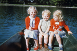 Boy and Two Girls in Red Sweaters Sitting in Back of Rowboat Photographic Print by G. Knapp